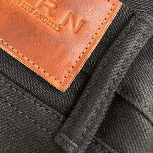 horn_rocker_bootcut_raw_selvage_denim_black_front_loop_patch_detail