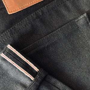 horn_rocker_bootcut_raw_selvage_denim_black_hem_pocket_detail