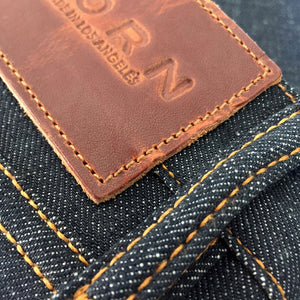 raw selvage denim jeans front loop patch detail