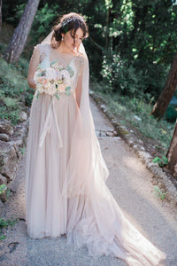 Delightful Champagne Tulle Wedding Dress With Amazing Details
