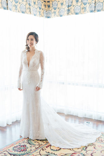 Feminine Sheer-Illusion Long-Sleeved Floor-Length Wedding Dress With A Chapel Train