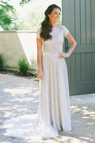 Flowing Outdoor Wedding Dress With Shiny Sequins And A Sultry V-Back