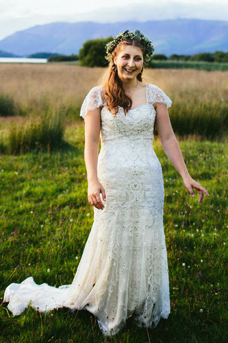 Glittering Cap-Sleeved Beaded Wedding Dress With Beautiful Patterns