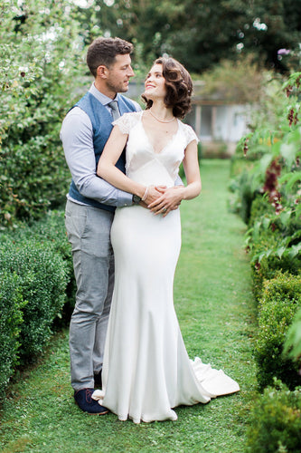 Sleek Fitted Silk Wedding Dress With A V-Neck And Cap Sleeves