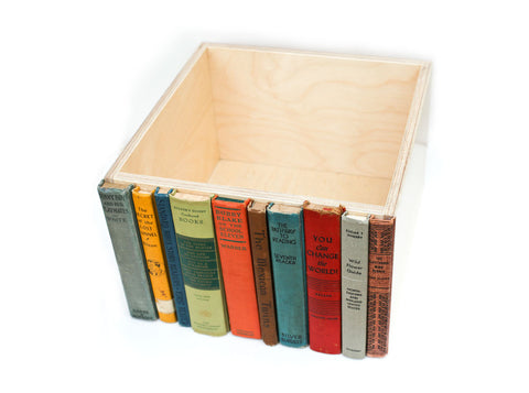 Decorative storage bin made with discarded library books.  A stylish, modern, way to hide, store, and organization kid's toys, dvds, cds, magazines, and clutter. Eco friendly and handcrafted in our California woodshop.