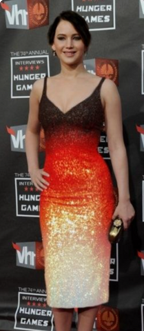 Jennifer Lawrence wearing a black, red, gold, and white Dior dress