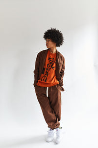ALLCAPSTUDIO LUMUMBA T-SHIRT - ORANGE