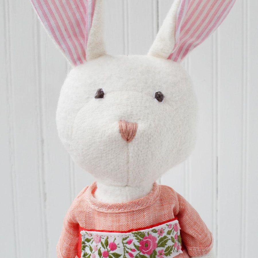 Hazel Village organic cotton Emma Rabbit. Dressed in Spring Outfit - coral linen dress and gold shoes