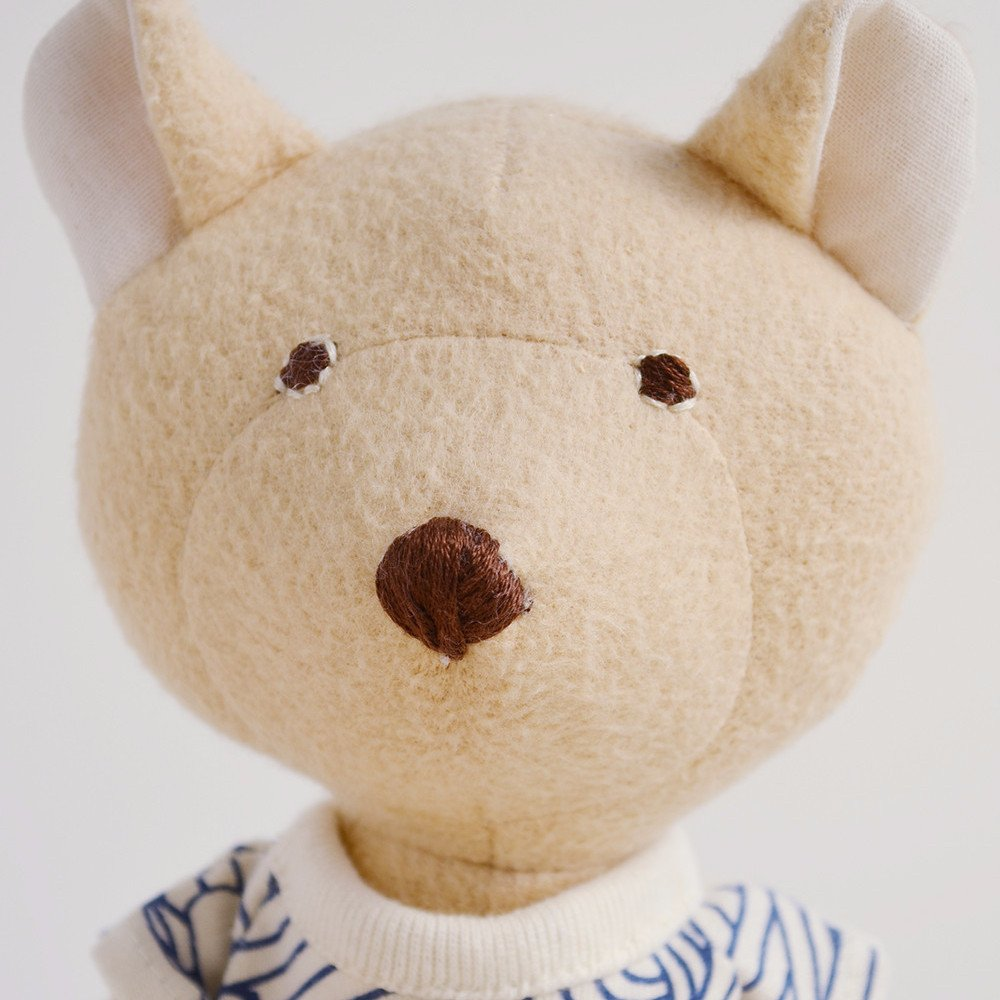 Close up of Hazel Village Nicholas Bear Cub in High Seas Romper