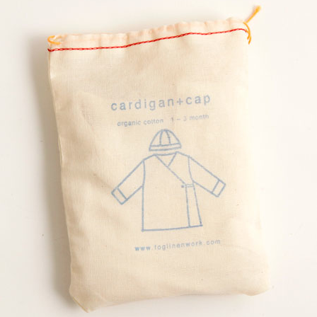 Cotton drawstring bag - packaging for Fog Linen Work Organic Cotton Baby Cap and Cardigan