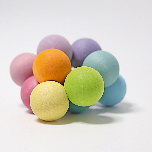 Grimm's Wooden Beads Grasper in pastel colours