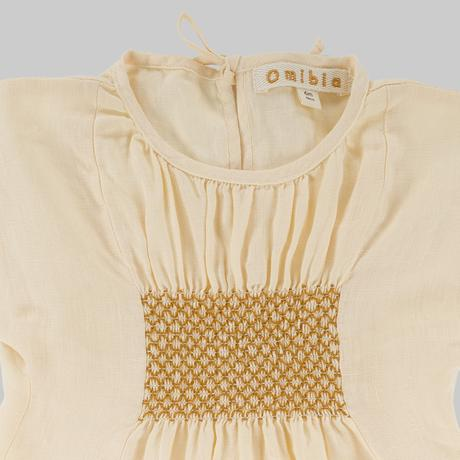 Close up of Omibia Bella organic linen dress in cream
