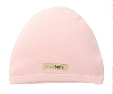 Baby wearing Loved Baby organic cotton cute cap in blush pink