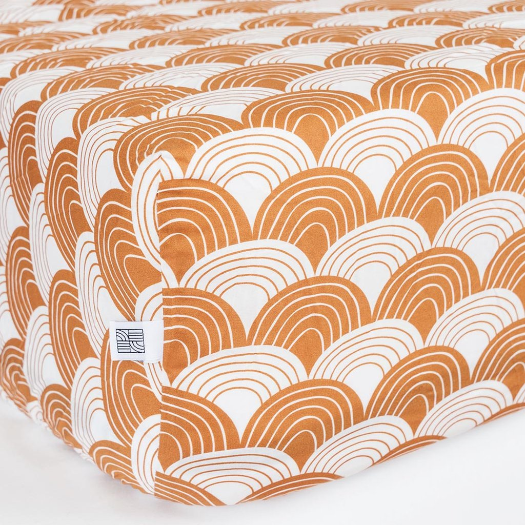 Swedish Linens Cinnamon Rainbows organic cotton sheet on a mattress
