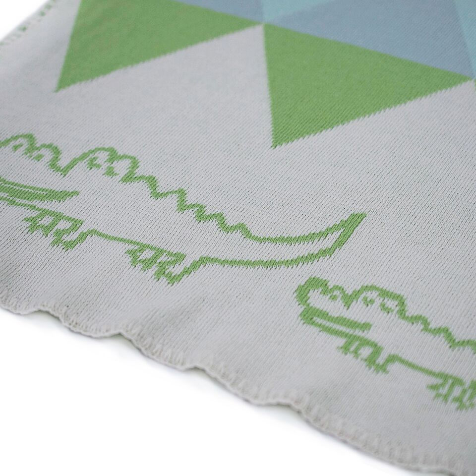 Close up of Koala Bubs organic cotton baby blanket in crocodile print