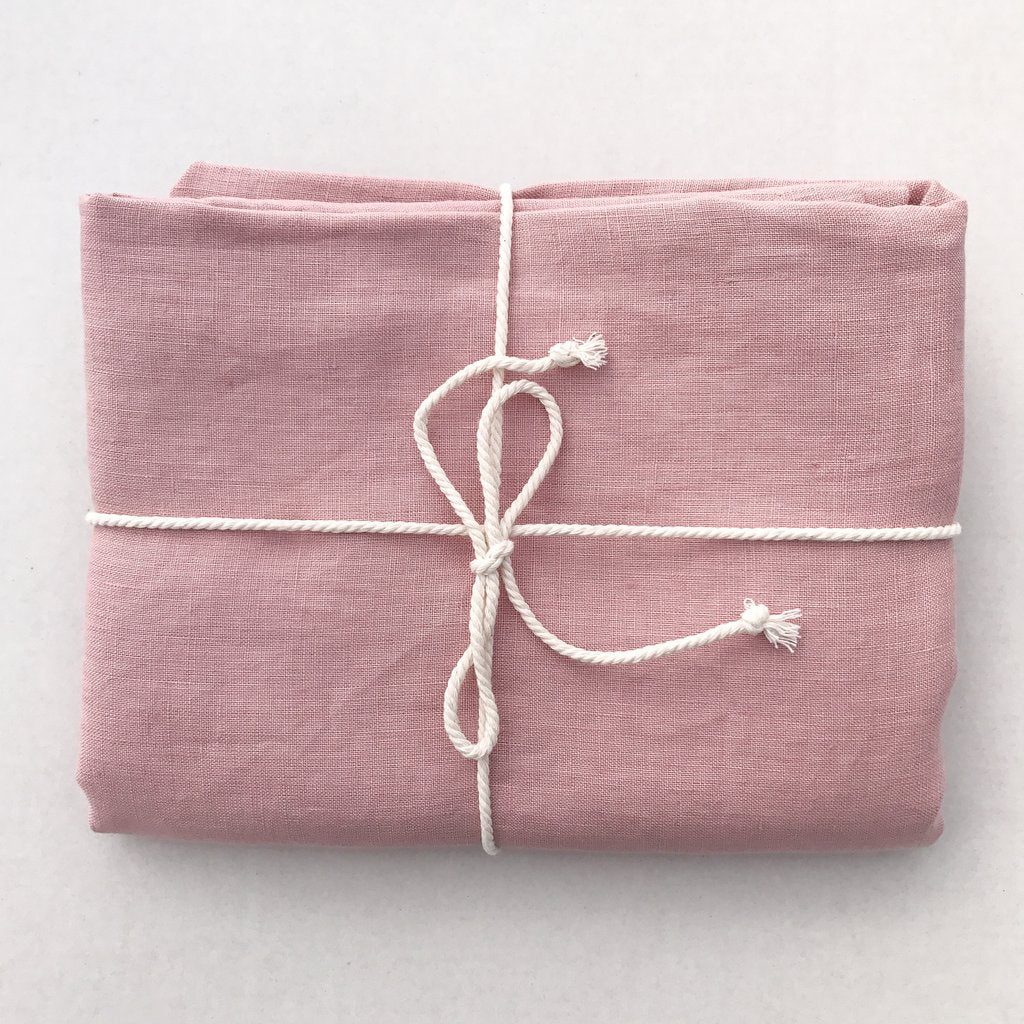 Dove and Dovelet pure french flax linen in dusty pink - range includes bassinet and cot sheets