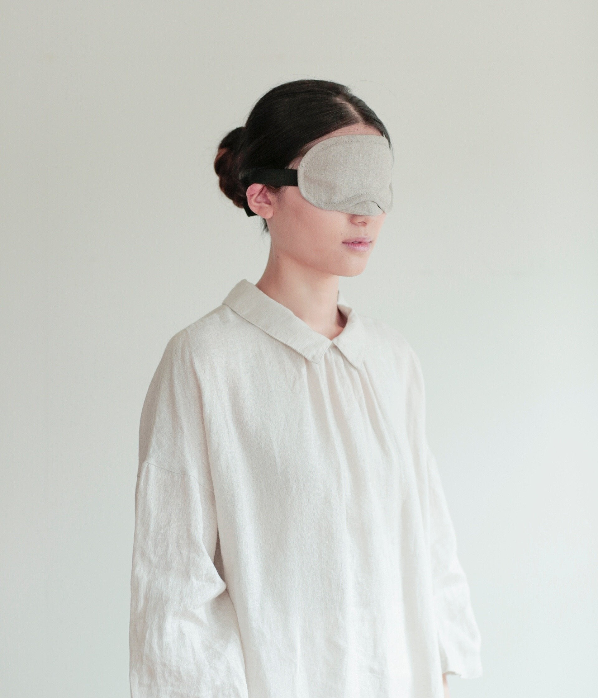 Model wearing Fog Linen Work linen eye mask