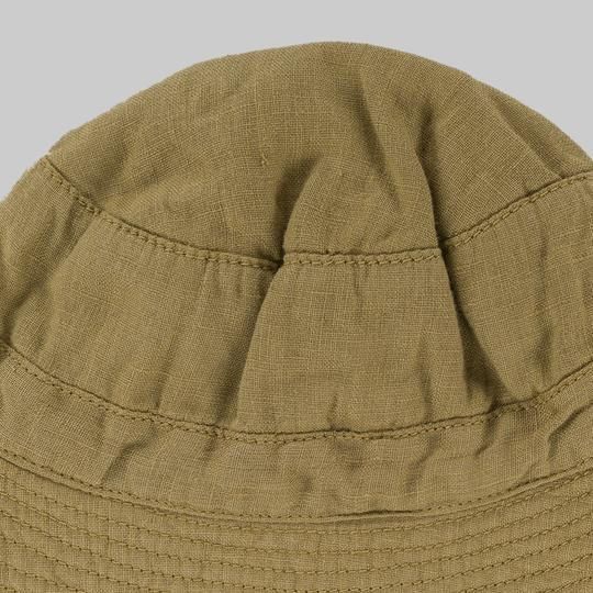 Close up of Omibia Francis linen baby hat in light oak