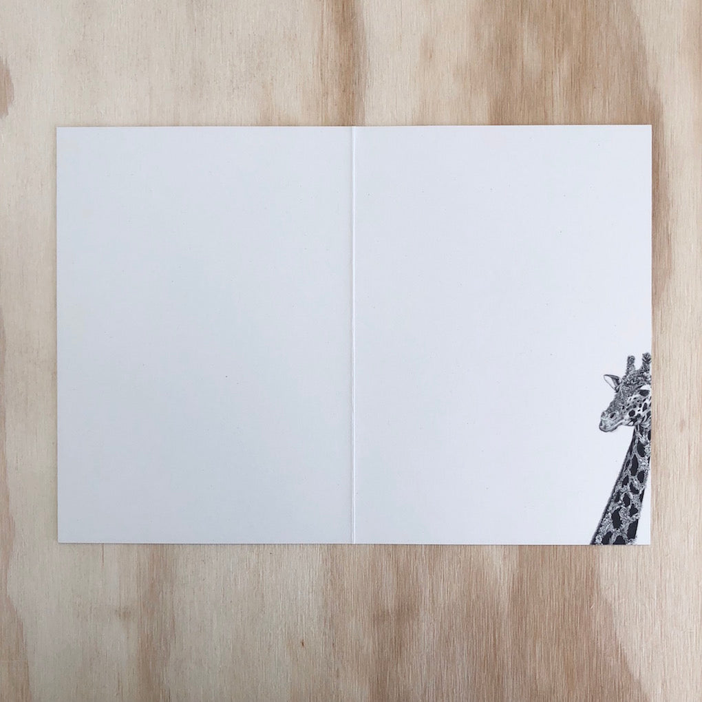 Marini Ferlazzo West African Giraffe greeting card - open showing the inside with a close up illustration of a West African giraffe on the bottom right hand side