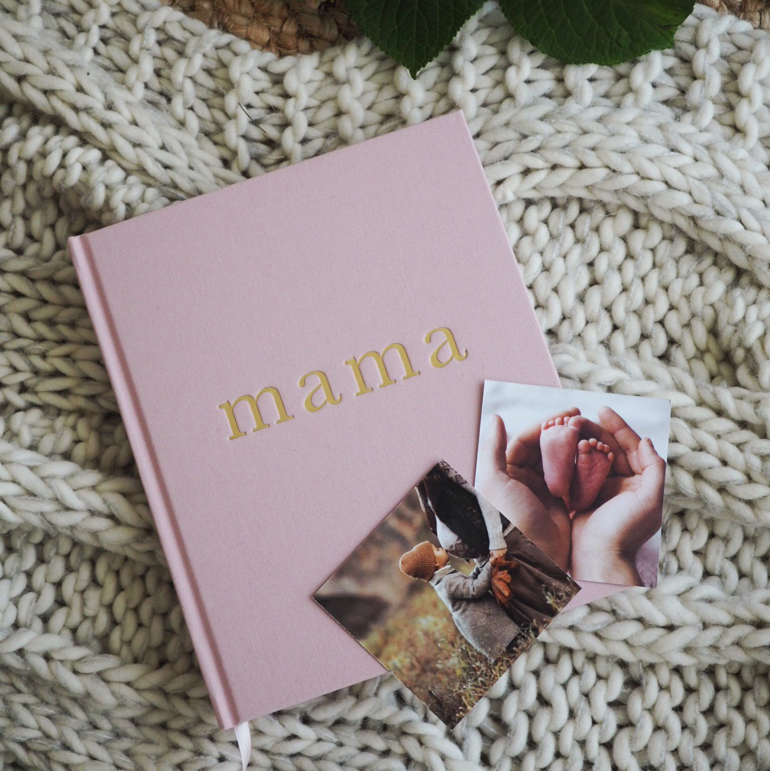 Write To Me Mama journal in pink on top of a white cable knit baby blanket