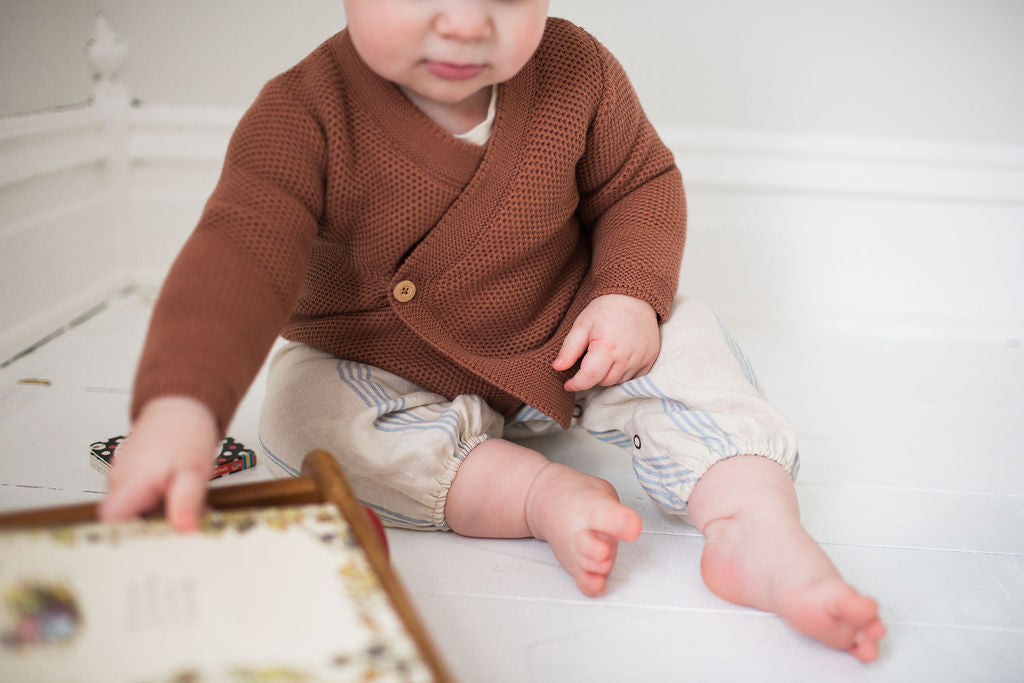 Child wearing Fin and Vince Wrap Cardigan Spice