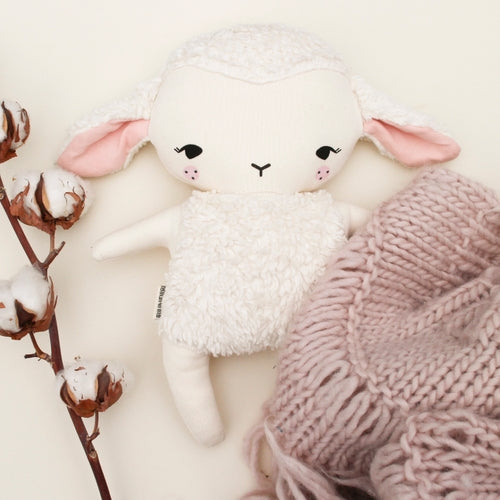 Bundis Organic Cotton Lamb - Lammy - soft toy flatlay with a pink blanket and white flowers