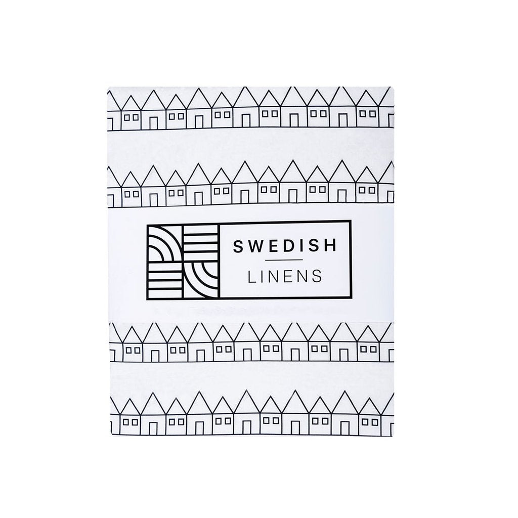 Packaging of the Swedish Linens organic cotton fitted sheet in the Lindbacken print in black and white
