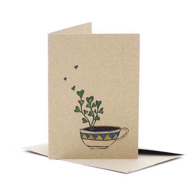 Deer Daisy kraft board greeting card that features an illustration of a succulent plant with love heart shaped leaves growing in a cup
