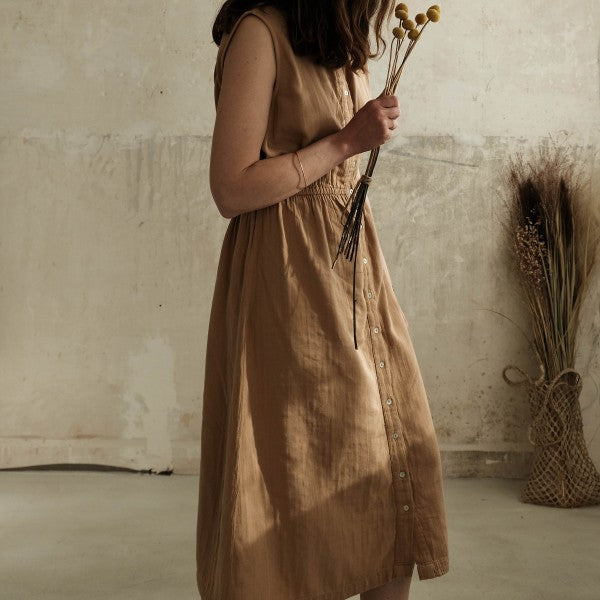 Model wearing Poudre Organic cotton Magnolia dress in Indian Tan