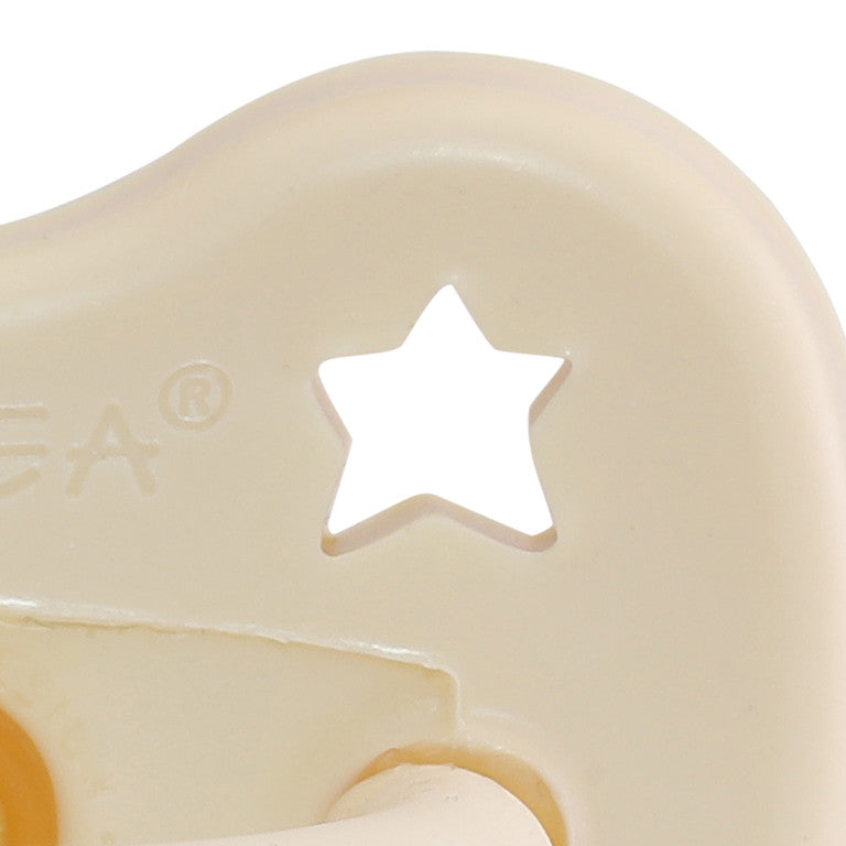 Close up of Hevea natural rubber colour pacifier - milky white