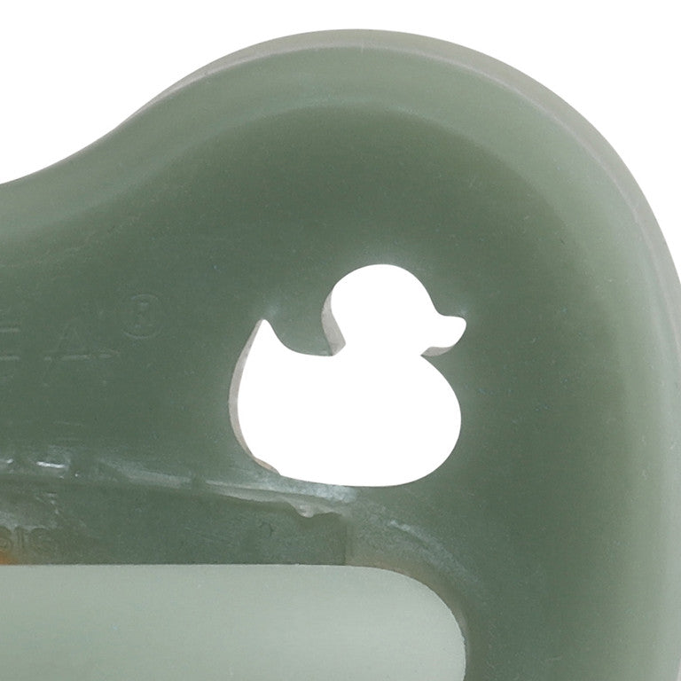 Close up of Hevea natural rubber colour pacifier - orthodontic teat - moss green