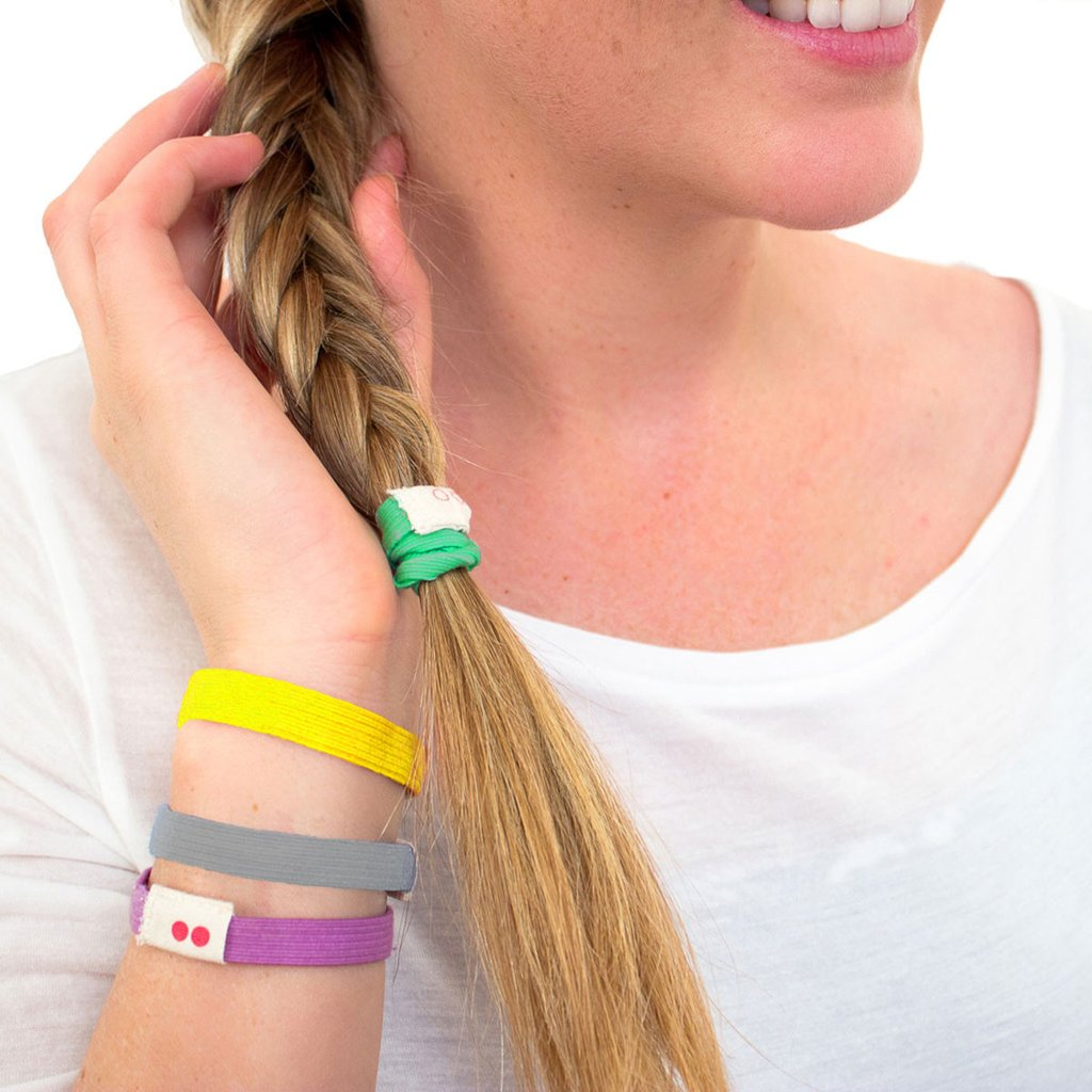 Model wearing Kooshoo organic cotton hair ties in multi colours