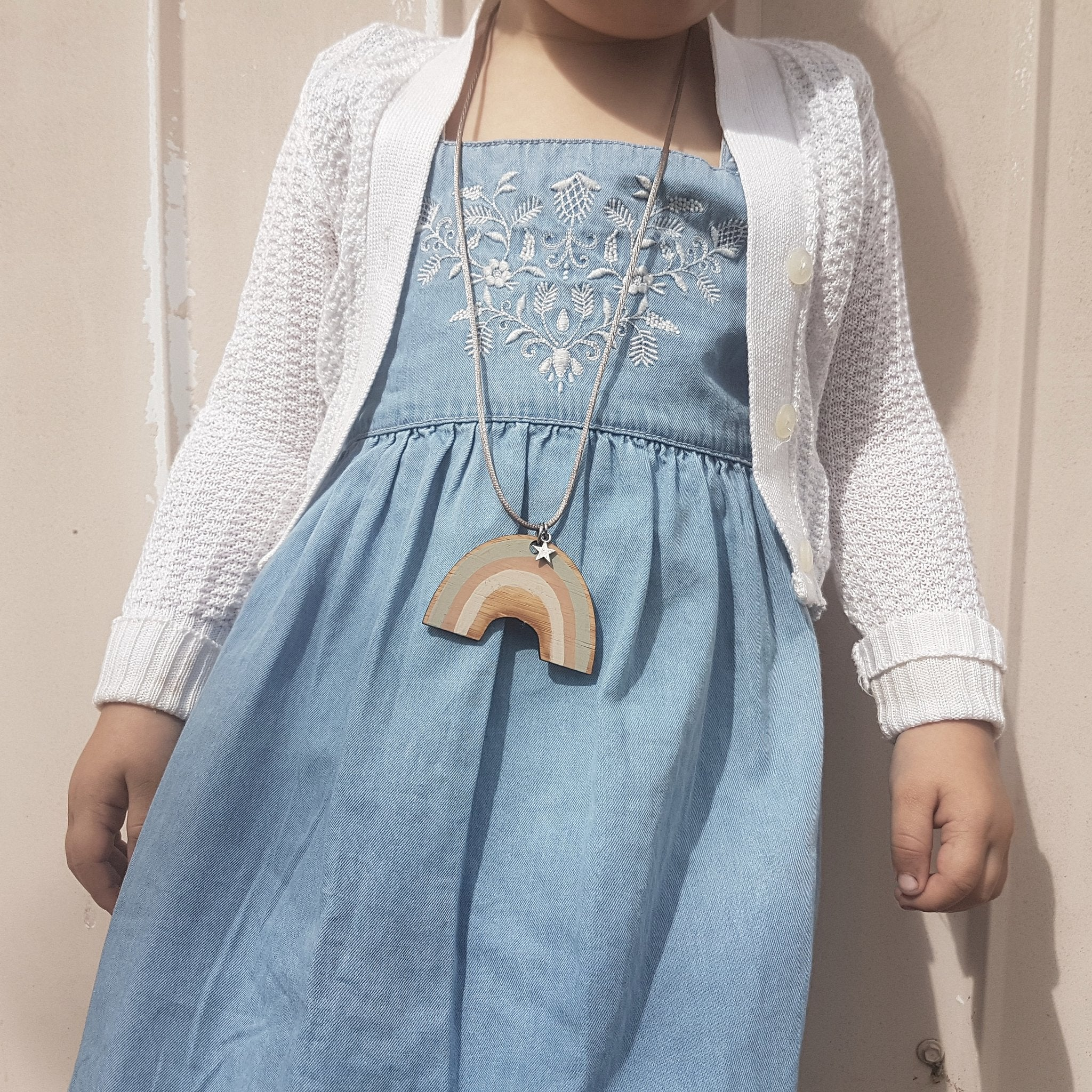 Toddler wearing Squirrel House Over The Rainbow bamboo necklace