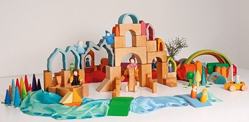 Grimm's wooden rainbow forest scene