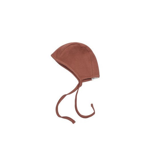 Little Indi organic cotton ribbed baby bonnet in rust