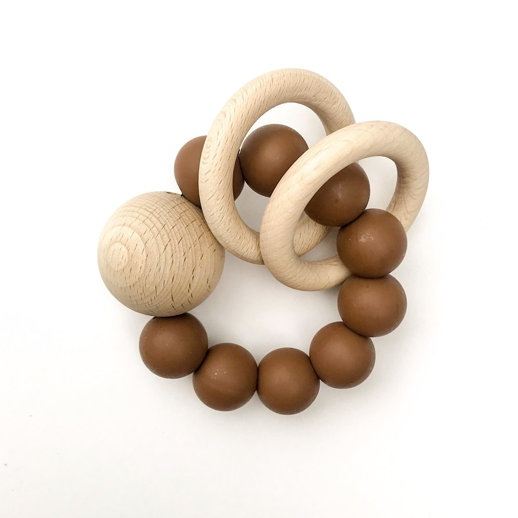 Dove and Dovelet Saturn Teething Rattle Toy in saddle