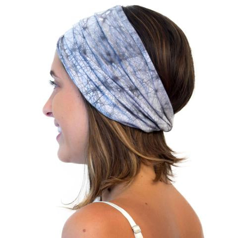 Sideview of model wearing Kooshoo organic cotton yoga twist headband in grey batik