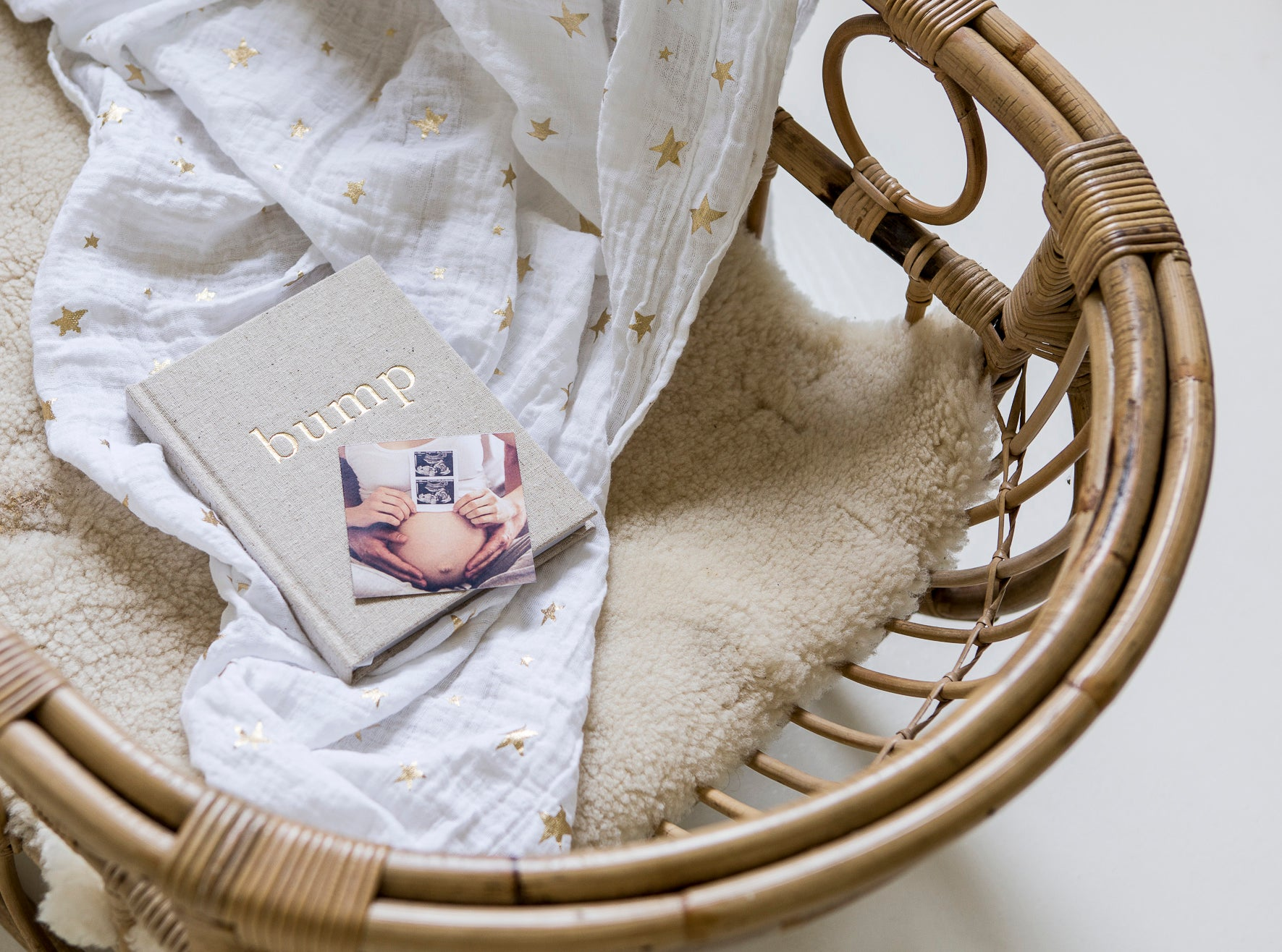 Write to Me linen baby journal in a cane bassinet