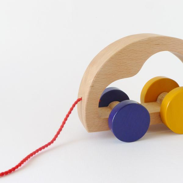 Close up of The Wandering Workshop wooden car pull toy