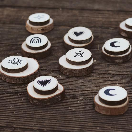 Nestling and Nook and WoodyMood - wooden slice memory game with hand stamped star, moon, rainbow, sun and heart