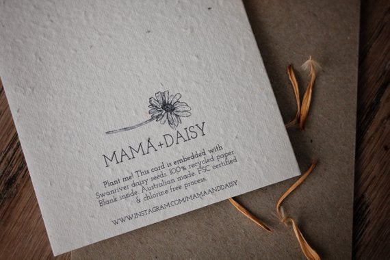 Close up of back of Mama and Daisy plantable seeded greeting card printed on recycled paper