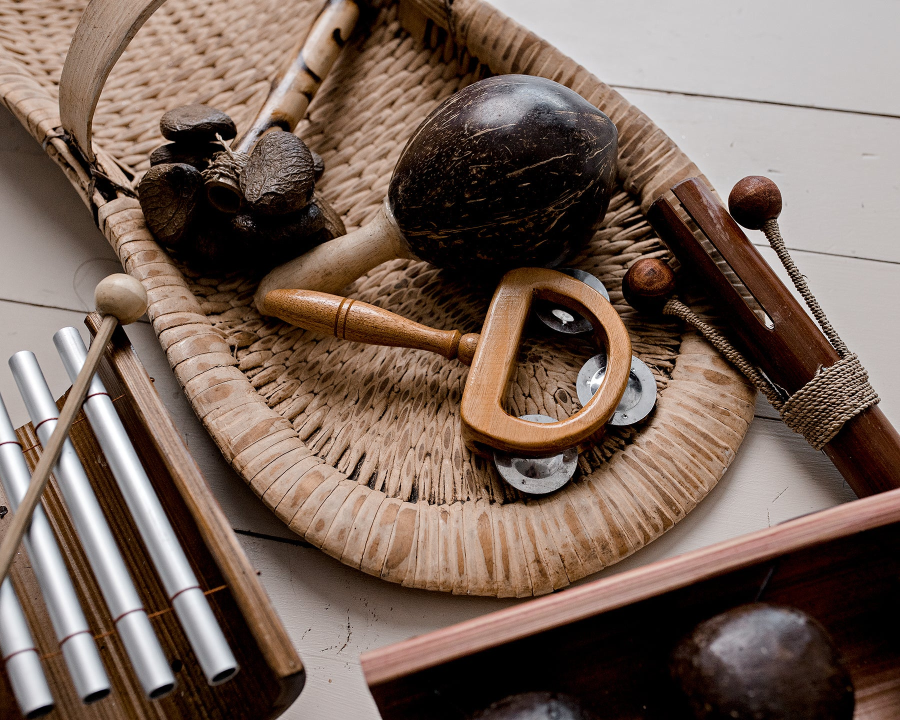 Papoose wooden musical instruments including wooden kenari, tambourine and coconut maraca