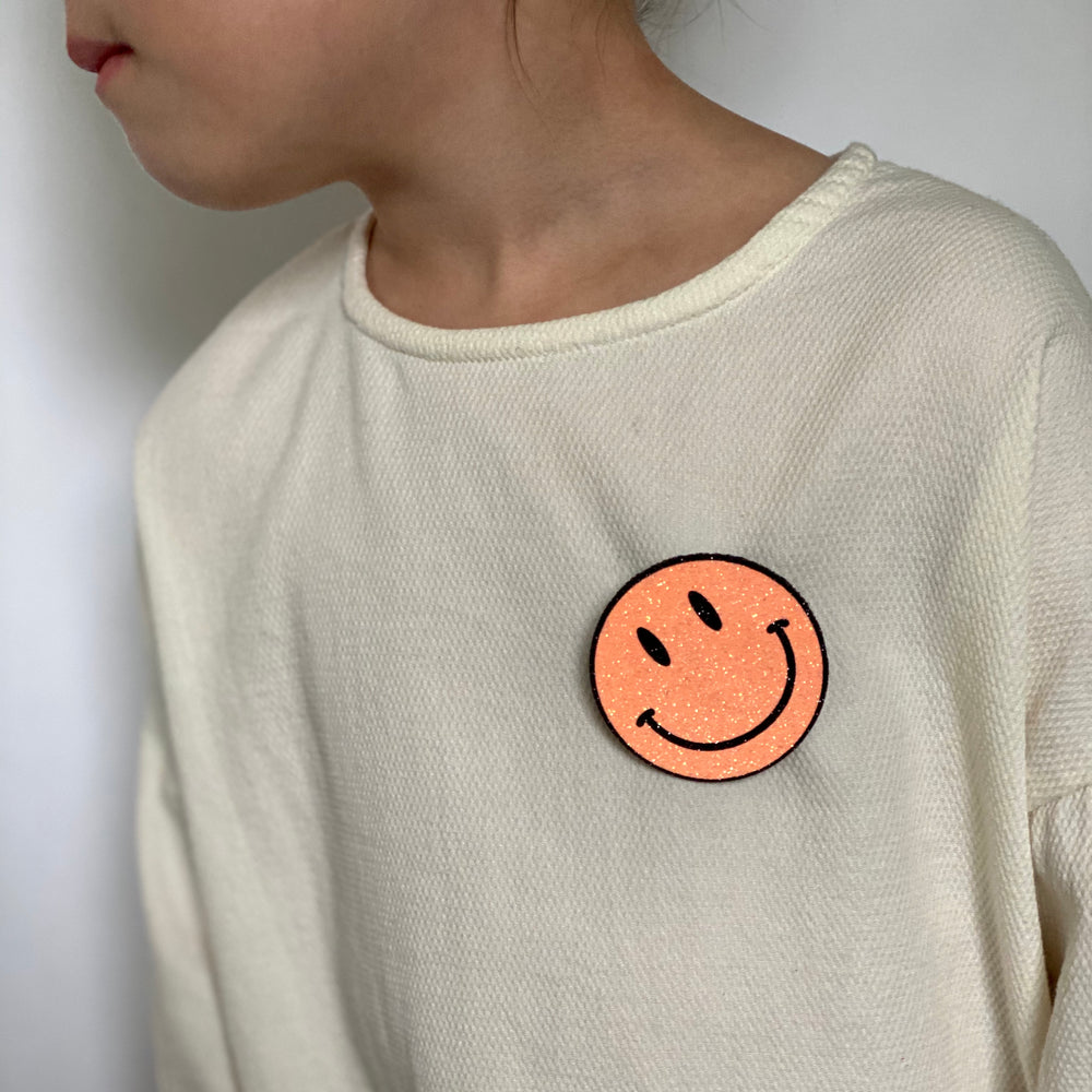 Badge Smiley Neon Orange