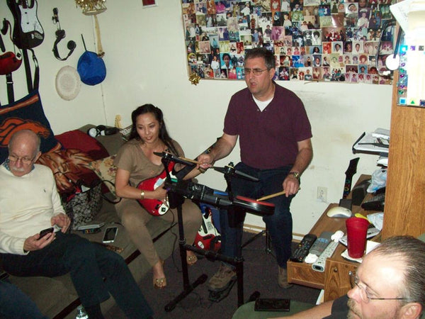 Kristie playing Rock Band with friends