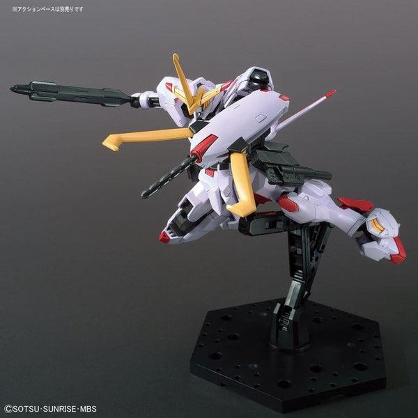 Bandai 1/144 HGIBO Gundam Hajiroboshi action pose with weapon.