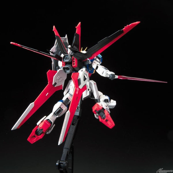 Bandai 1/144 RG Force Impulse Gundam action pose rear view