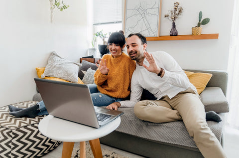 Stock image man and woman on couch in front of laptop