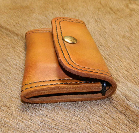 "Leather Speed Strip Pouch for 410 shells, 2-1/2"". Uses ONE 44/45 cal six cartridge Bianchi style strip. Belt, bag, pocket carry. Antiqued Golden Brown 44-013"