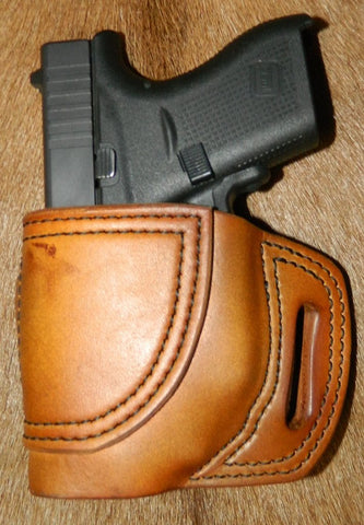 Gary C's Avenger Left Hand Holster for Glock G42 380 with Crimson Trace Green Laser.  Antiqued Golden Brown Leather BBL-004