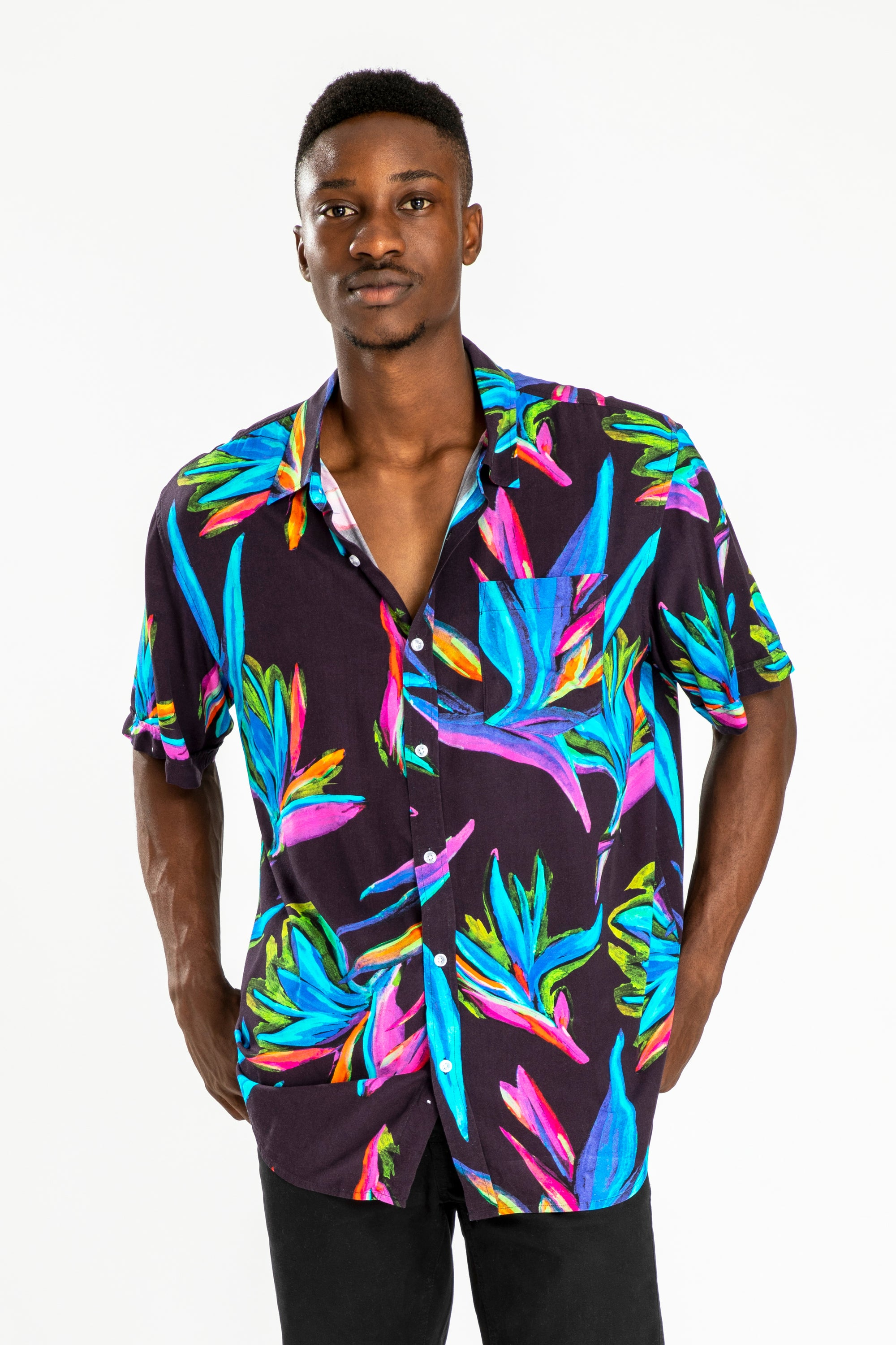 men's short sleeve party shirt by Poolside Party Shirts with multi colour bird of paradise print on black background front view